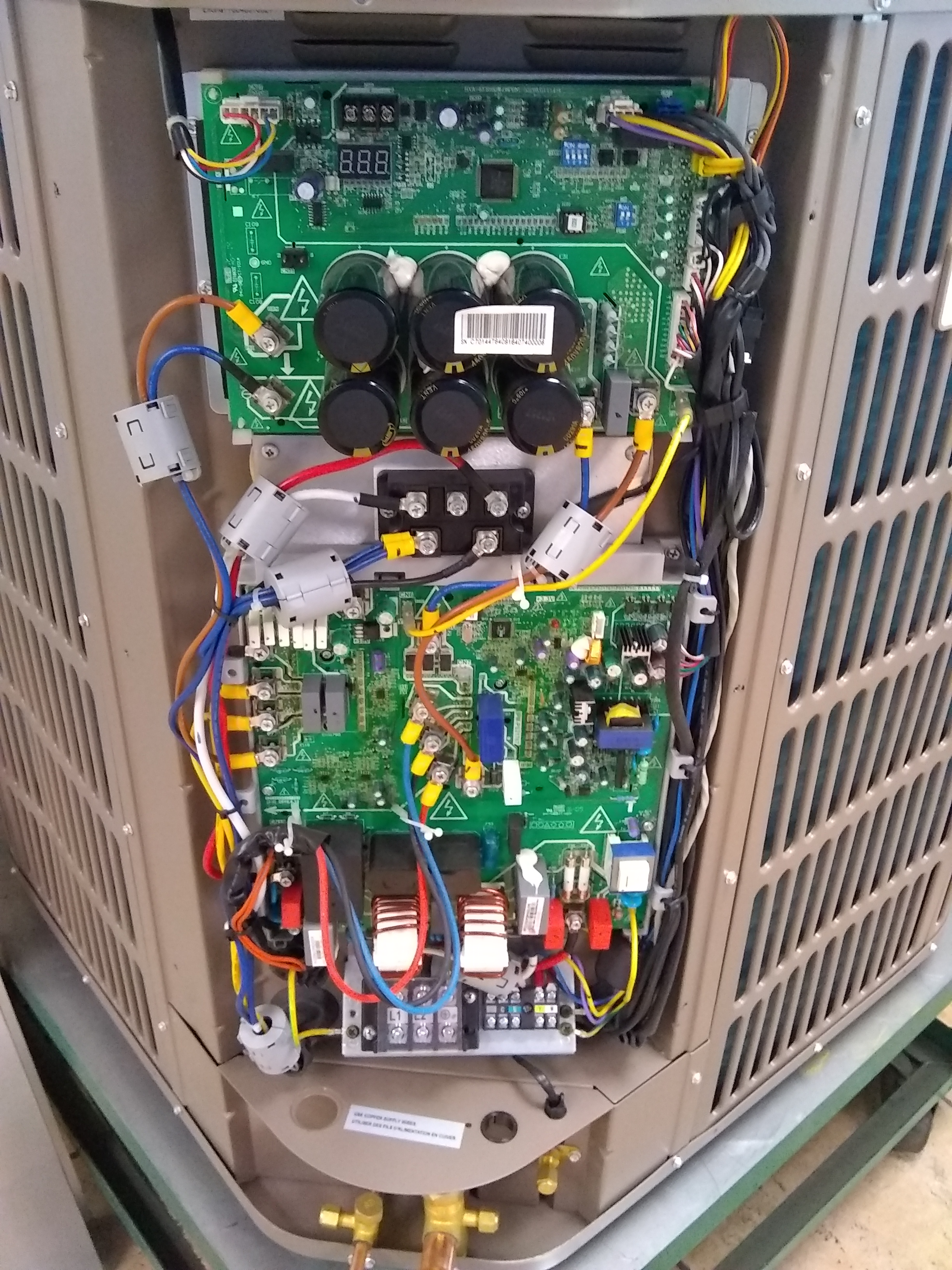 inverter circuit board inside 18 SEER heat pump unit