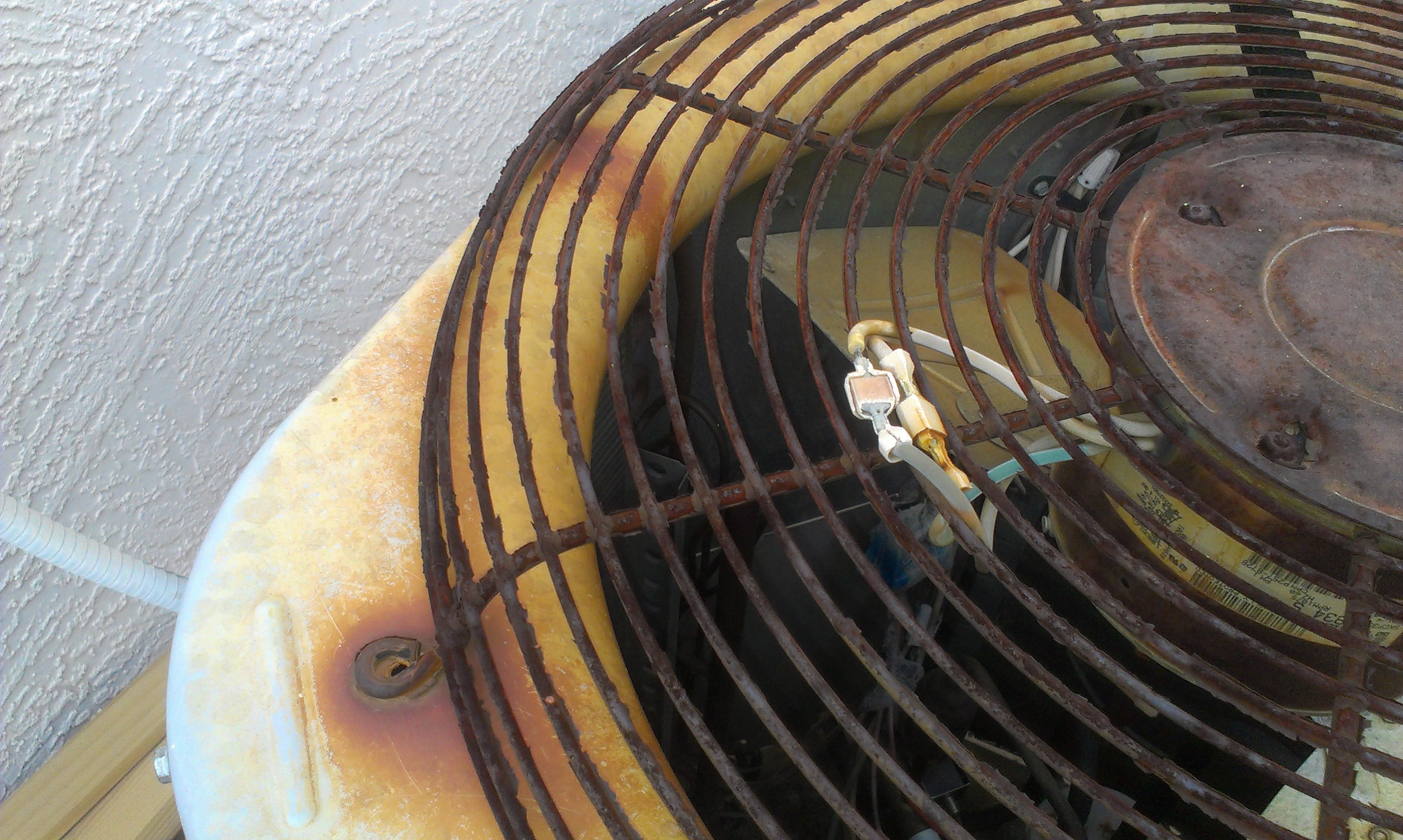 condenser fan motor with the reverse leads sticking out of the top of the fan grill