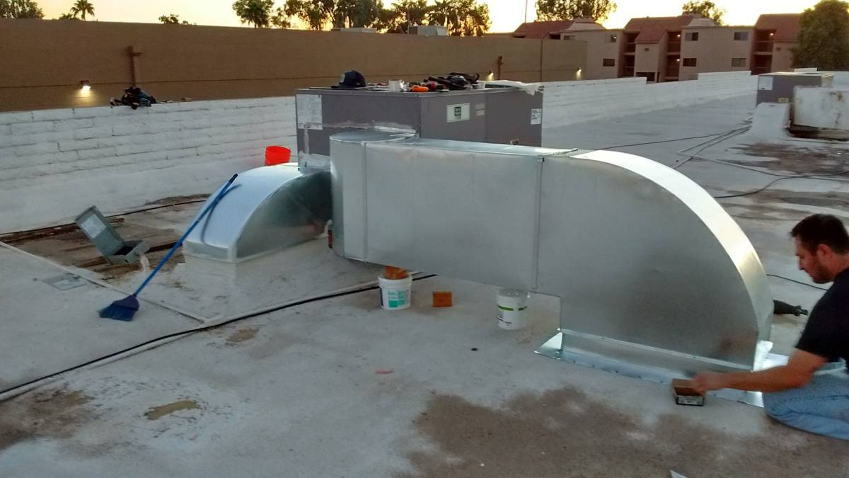 Day and Night commercial heat pump ducting being installed