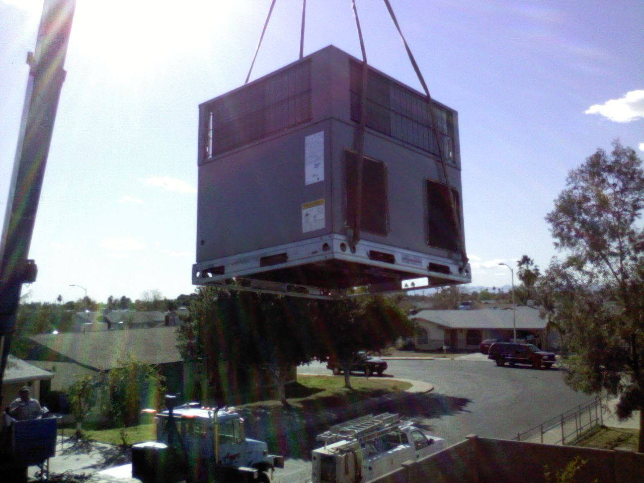 Heil heat pump unit hoisted up to roof by crane